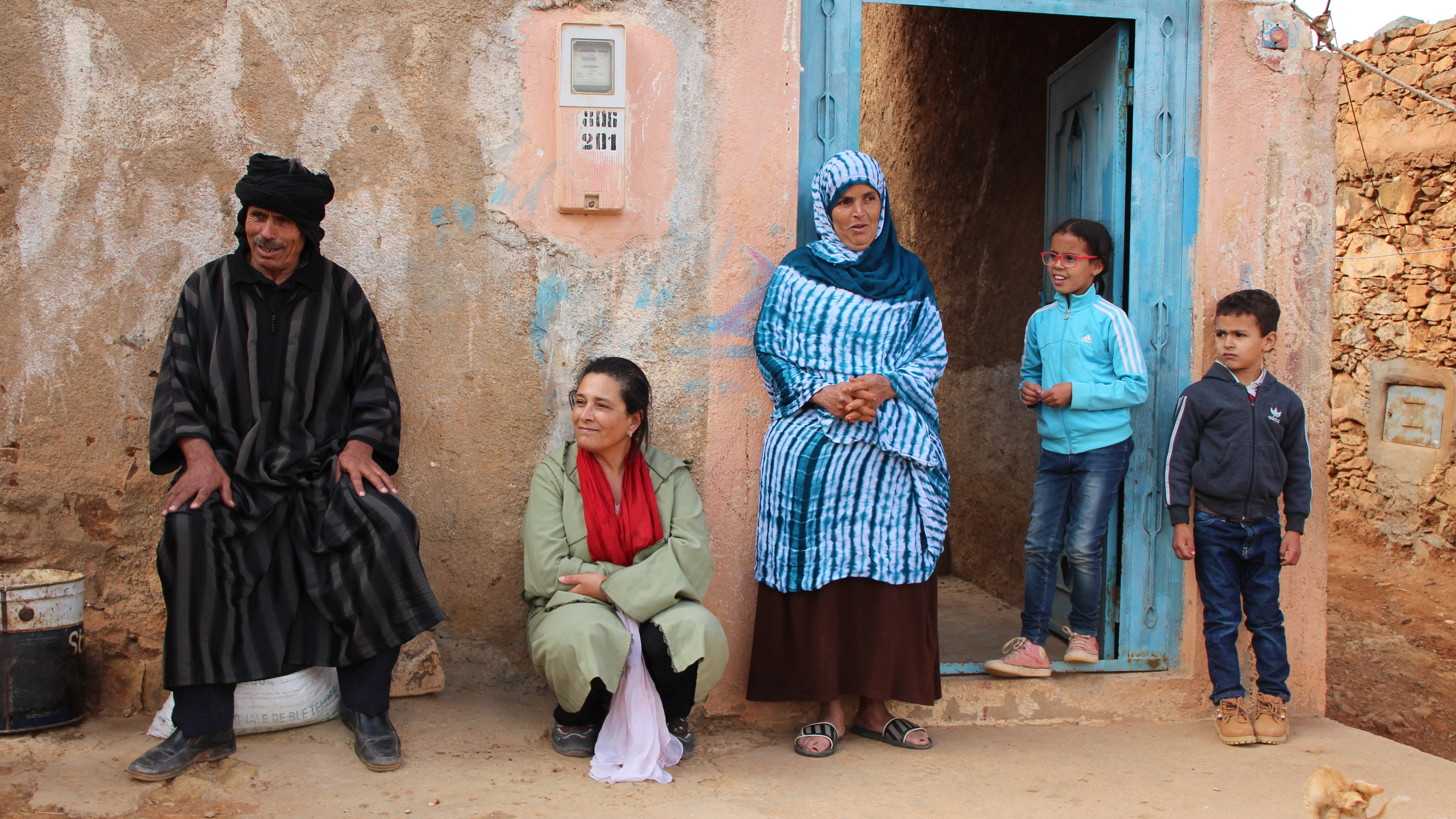 "The Ischar family and Jamila Bargach from Dar Si Hmad (2nd from left) in front of the family's home. ""Our quality of life is now much better,"" says the mother, Salka Ischar (centre)."